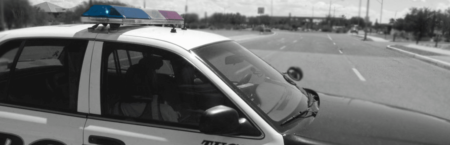 A cop car on the road. Learn more about the future of breathalyzers