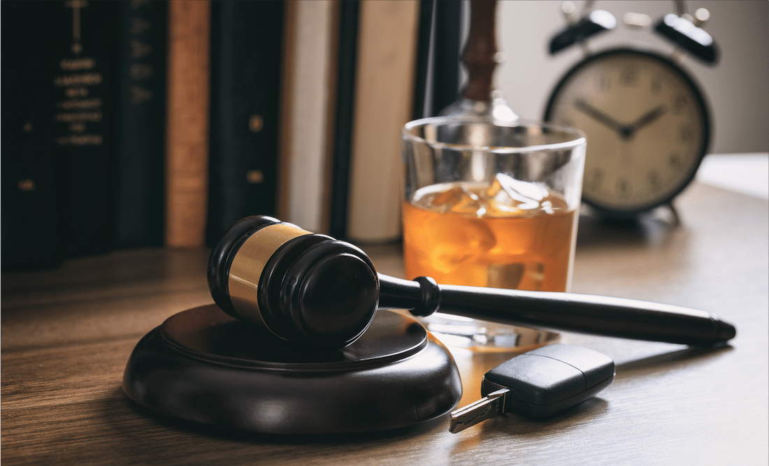 A gavel sitting next to an alcoholic beverage, representing a DUI lawyer