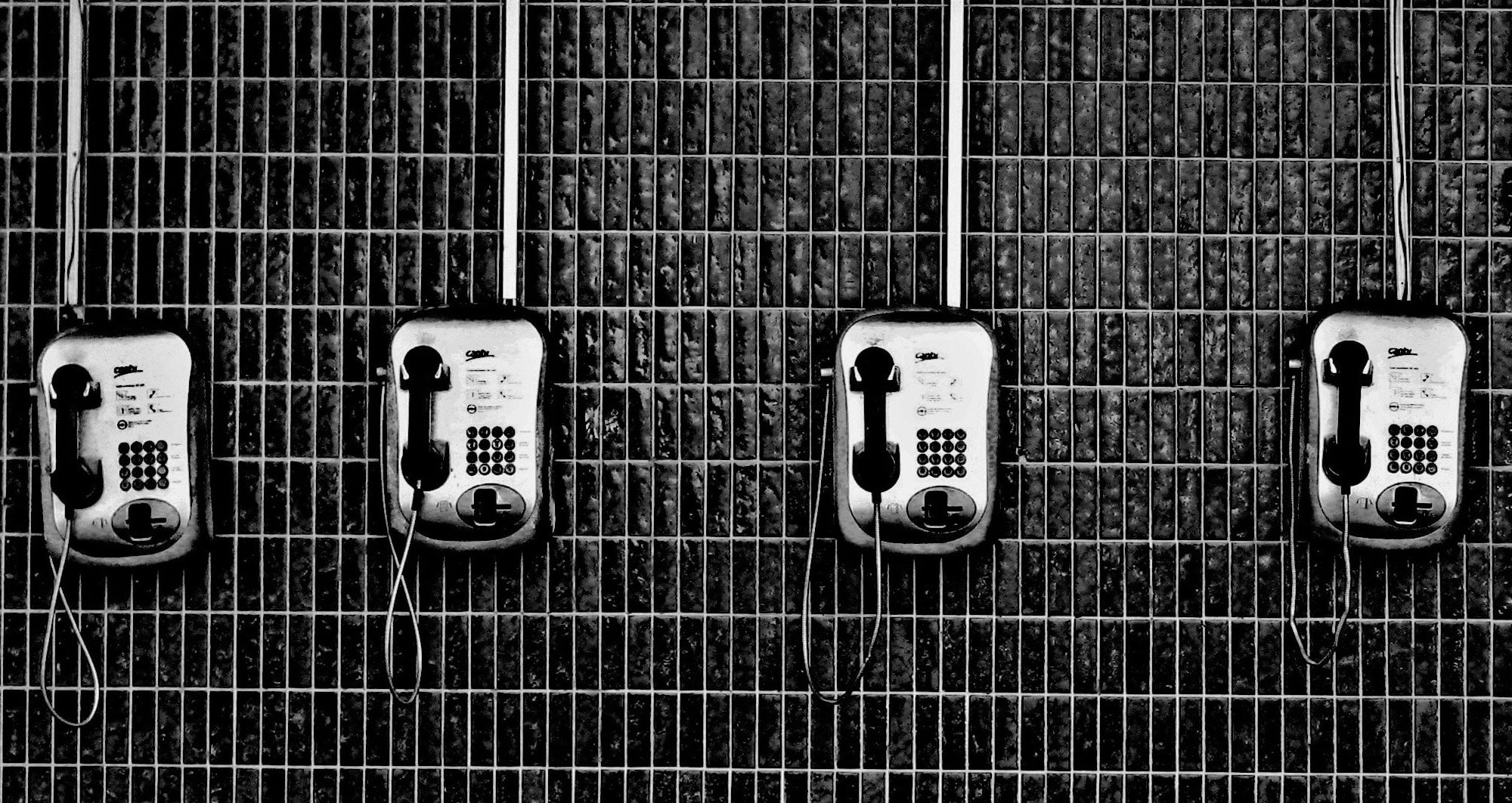 A line of phones, as in a prison cell after celebrity DUI's