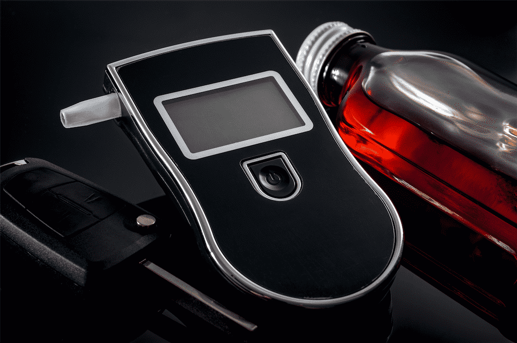 A breathalyzer device in a car