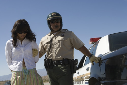 A woman being arrested for a prescription drug DUI