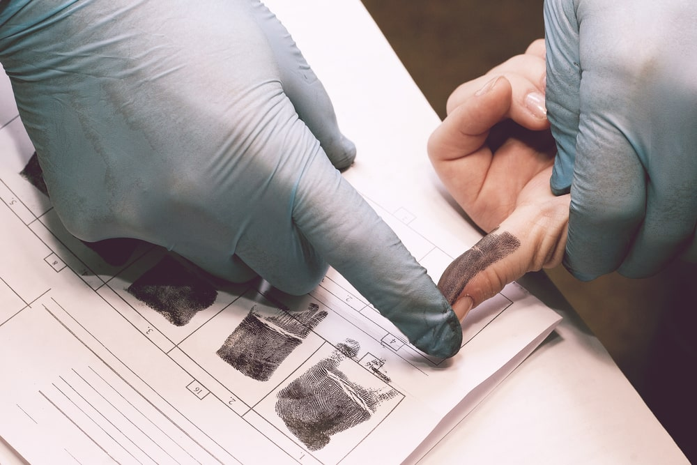 A person gives fingerprints after an arrest for a misdemeanor or felony