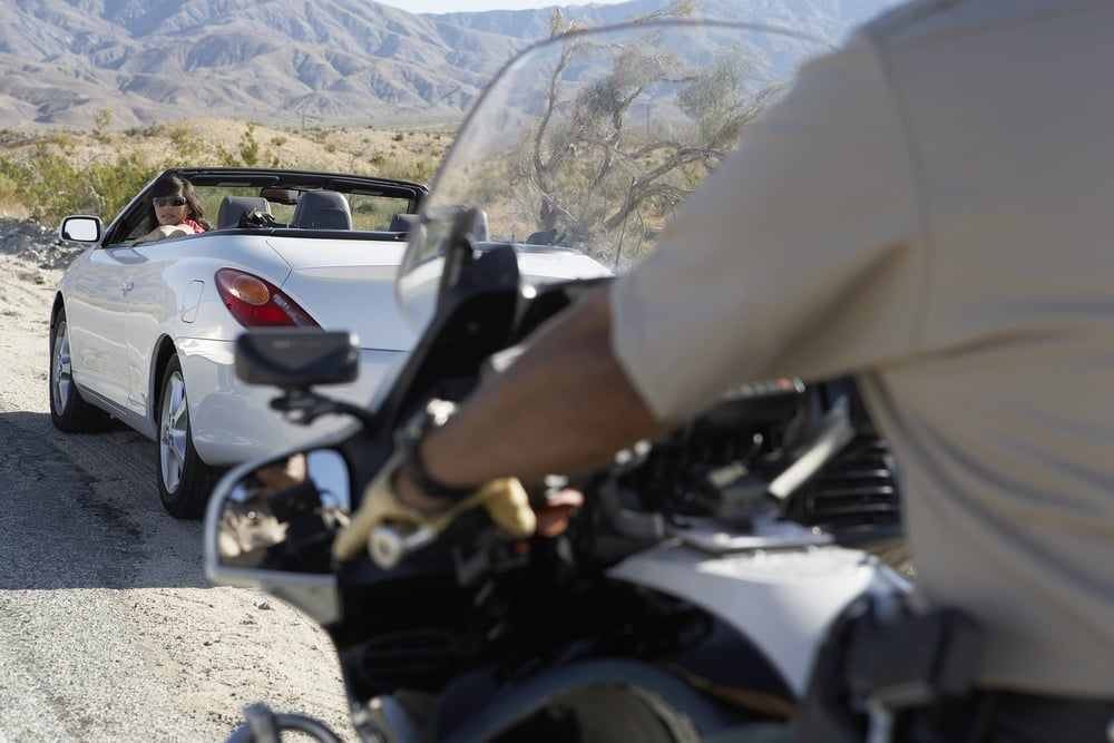 A traffic stop on a desert road that could lead to a license suspension