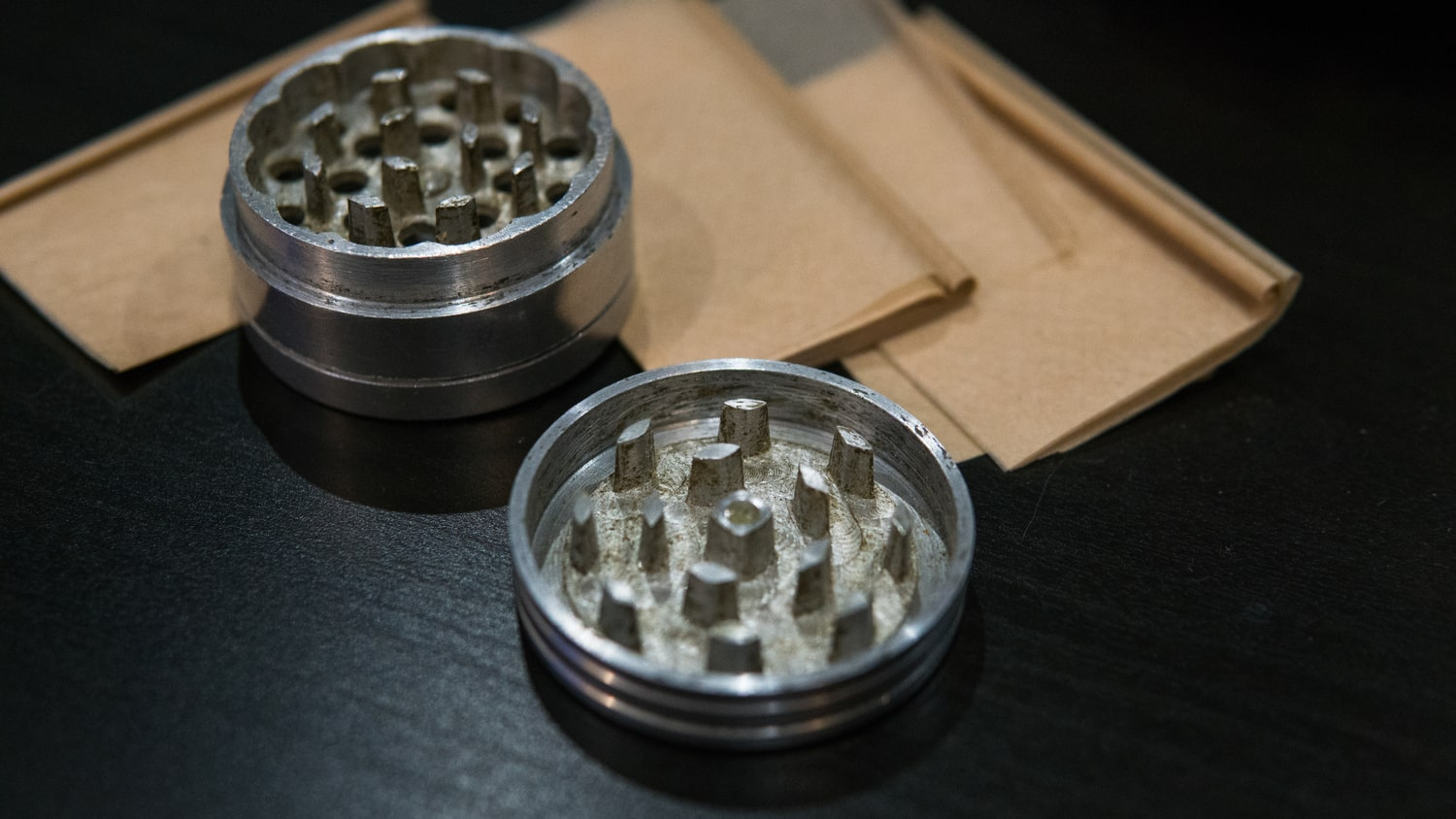 An herb grinder and rolling papers, two items that could be considered drug paraphernalia under ARS 13-3415