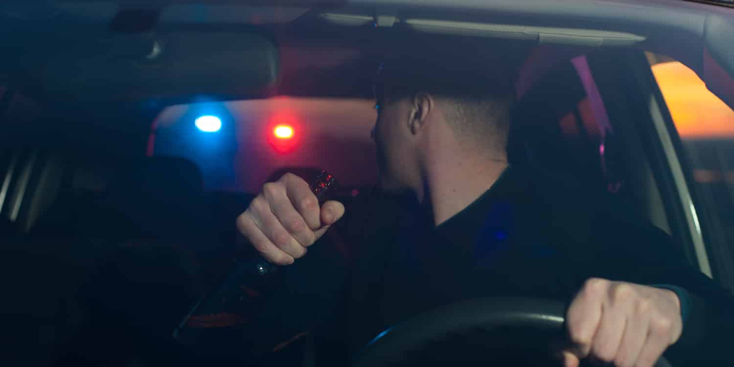 A man being stopped by the police for drinking and driving