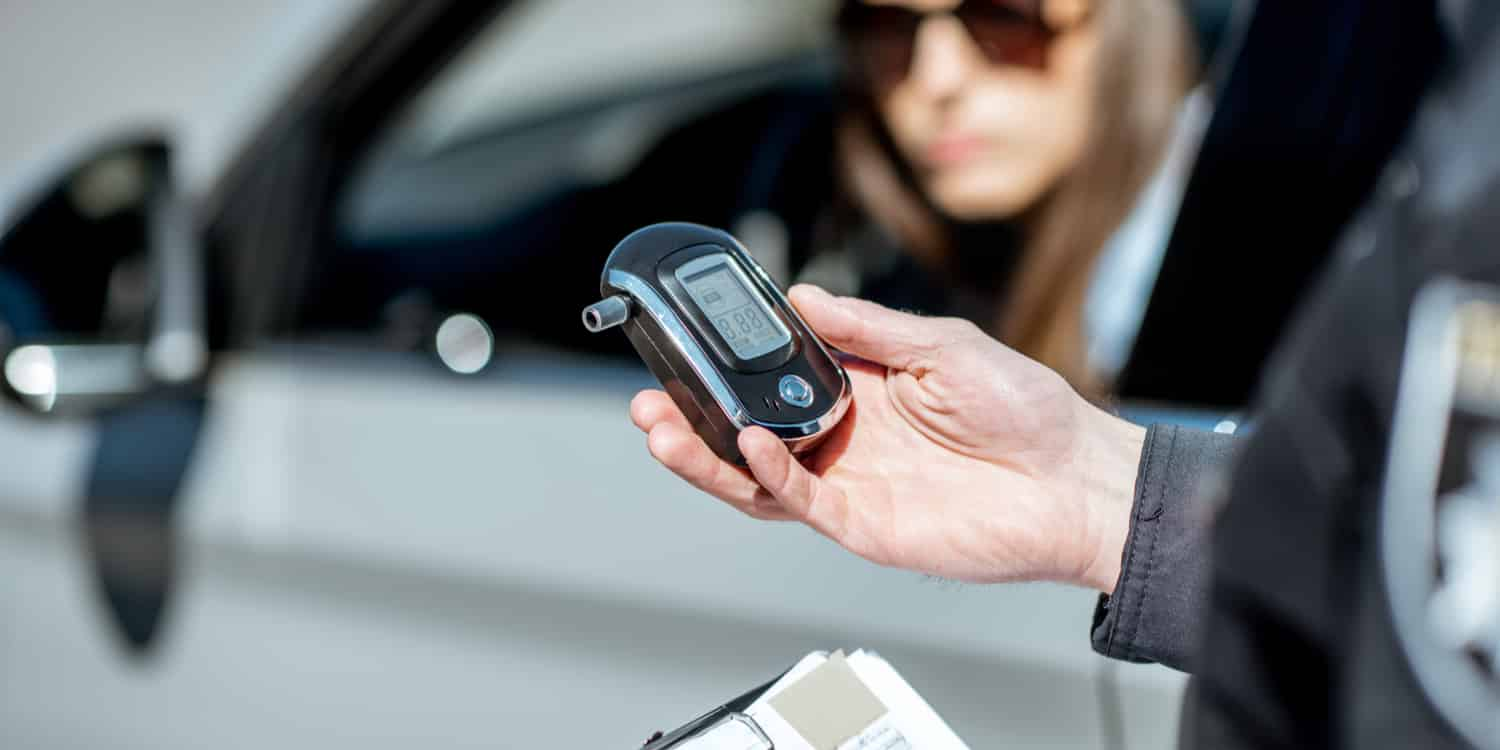 A woman taking a breath test as part of Arizona's implied consent law